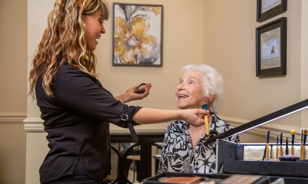 Resident having makeup done at the Salon inside Azalea Estates Gracious Retirement Living in Chapel Hill, North Carolina