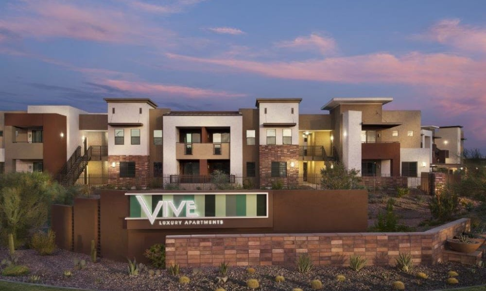 Dusk view of our sign and resident buildings at Vive in Chandler, Arizona