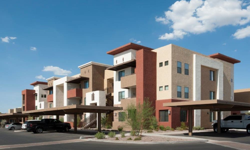 Exterior view of resident buildings and covered parking at Vive in Chandler, Arizona