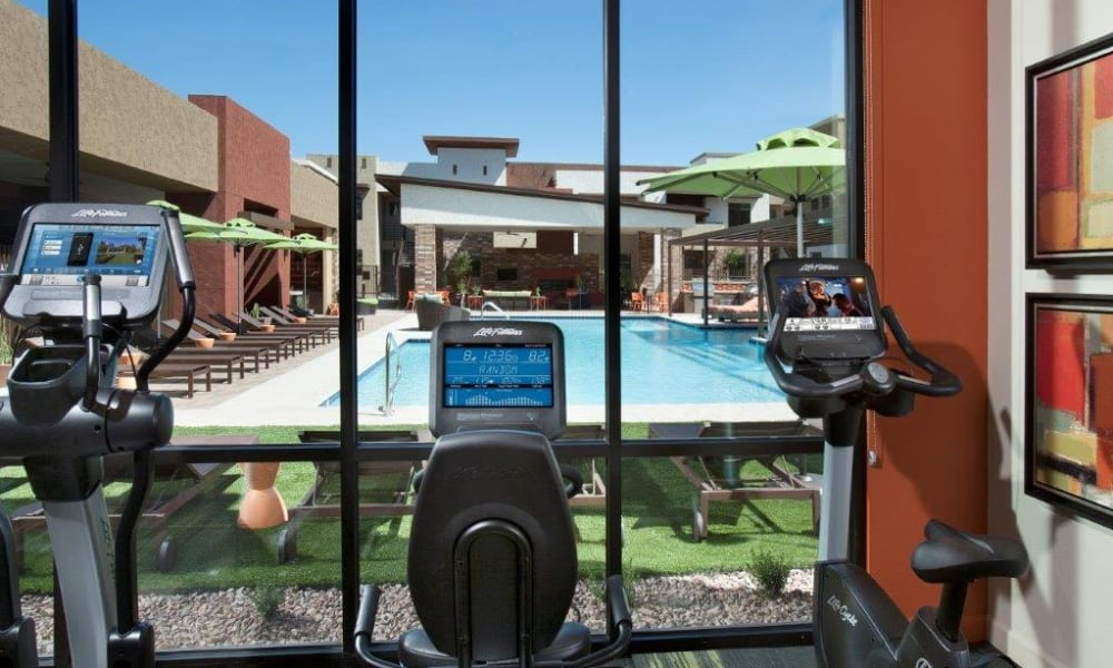 Great view of the swimming pool from the cardio equipment in the fitness center at Vive in Chandler, Arizona