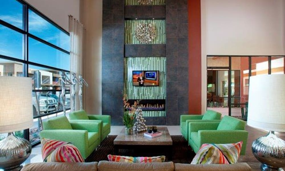 Flatscreen TVs and a fireplace in the clubhouse lounge at Vive in Chandler, Arizona