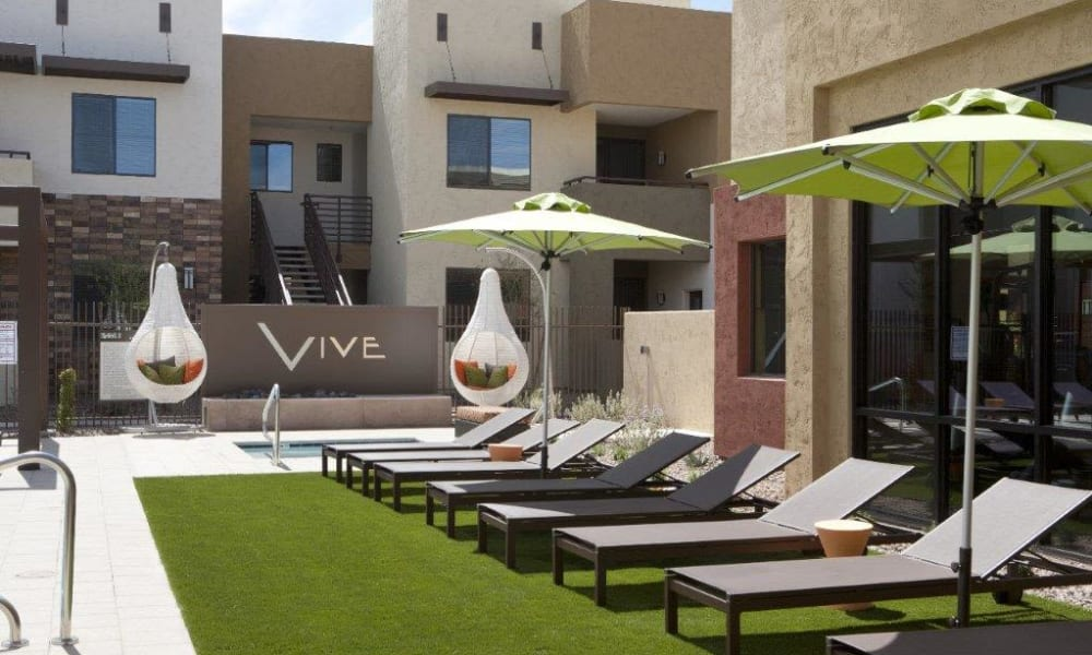 Chaise lounge chairs near the pool at Vive in Chandler, Arizona