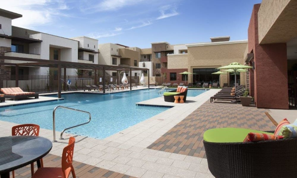 Resort-style swimming pool on a beautiful day at Vive in Chandler, Arizona