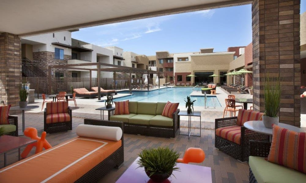 Expansive covered outdoor lounge near the pool at Vive in Chandler, Arizona
