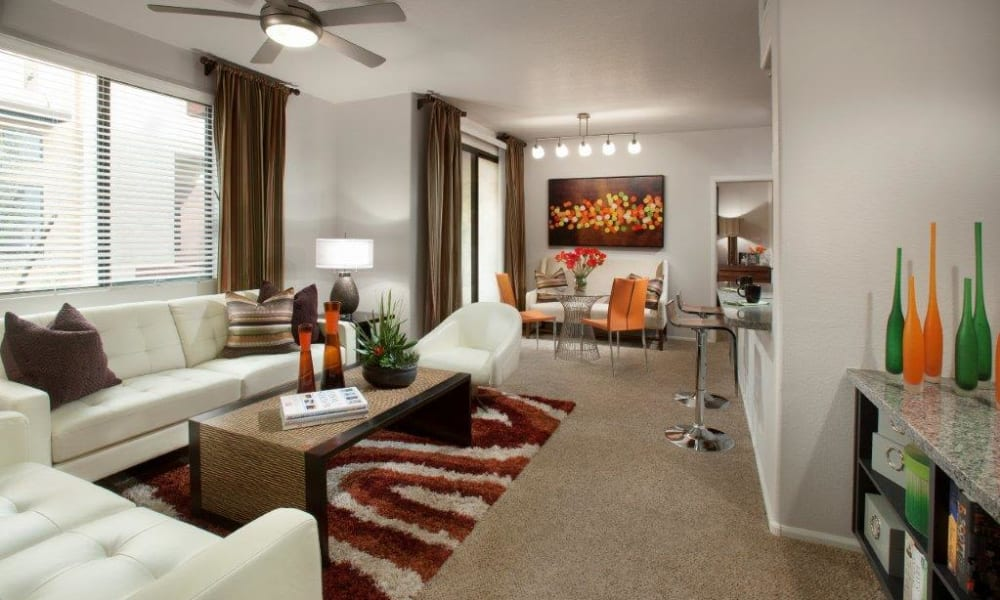 Ceiling fan and plush carpeting in the living area of a model home at Vive in Chandler, Arizona