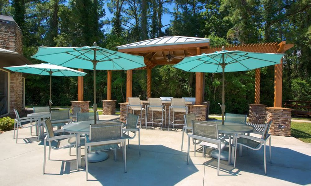 Shaded seating near the barbecue area at Wimberly at Deerwood in Jacksonville, Florida