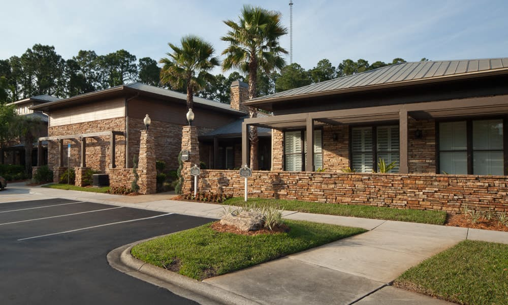 Exterior view of the leasing center on a beautiful morning at Wimberly at Deerwood in Jacksonville, Florida