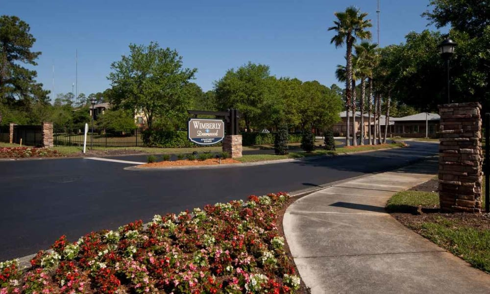 Professionally maintained landscaping at the entrance to Wimberly at Deerwood in Jacksonville, Florida