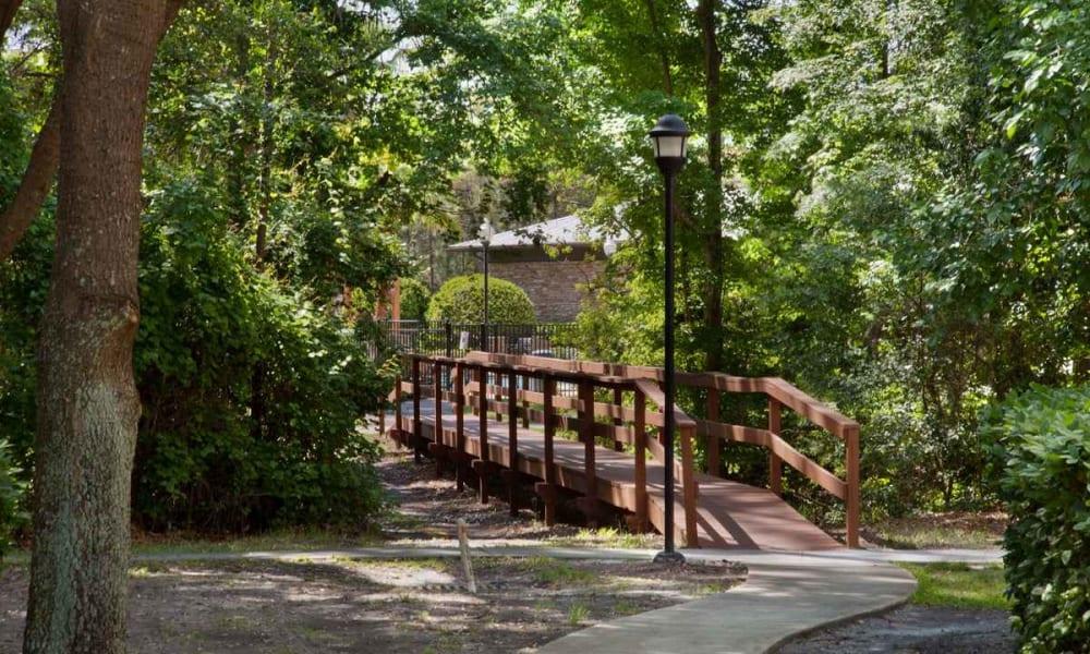 Wooden bridge across a creek at Wimberly at Deerwood in Jacksonville, Florida