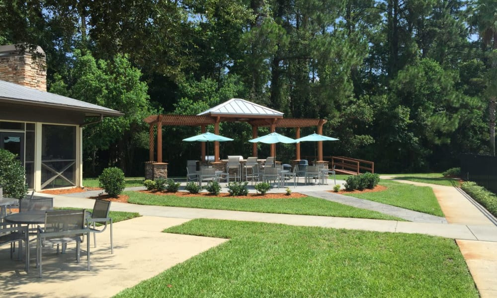 Beautifully maintained lawns between walking paths at Wimberly at Deerwood in Jacksonville, Florida
