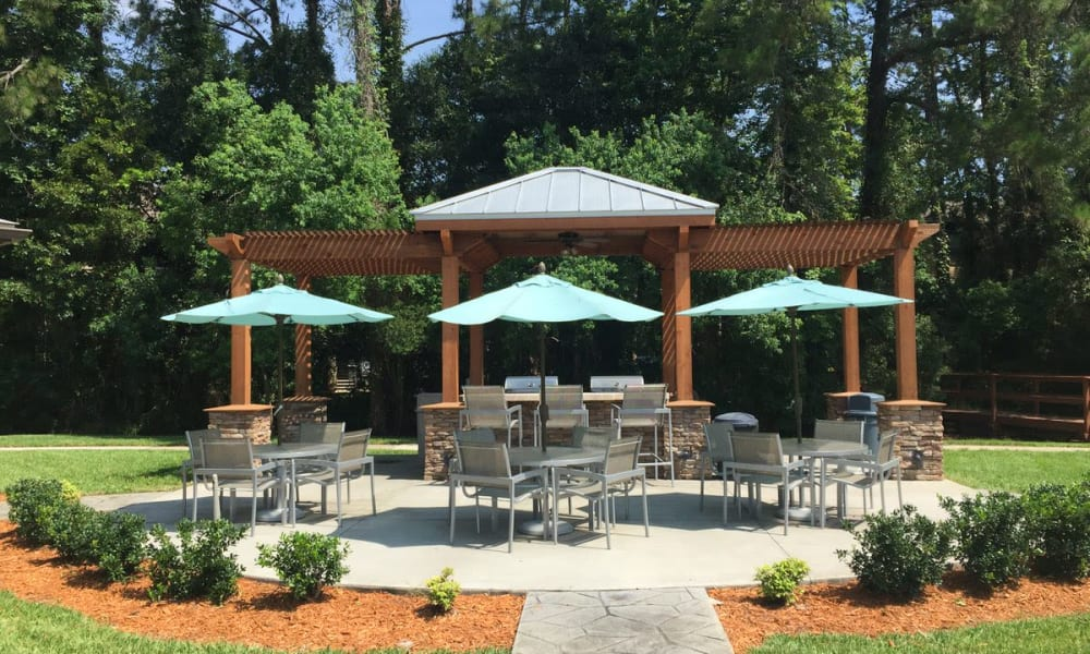 Expansive gazebo and pergola over the large barbecue area at Wimberly at Deerwood in Jacksonville, Florida