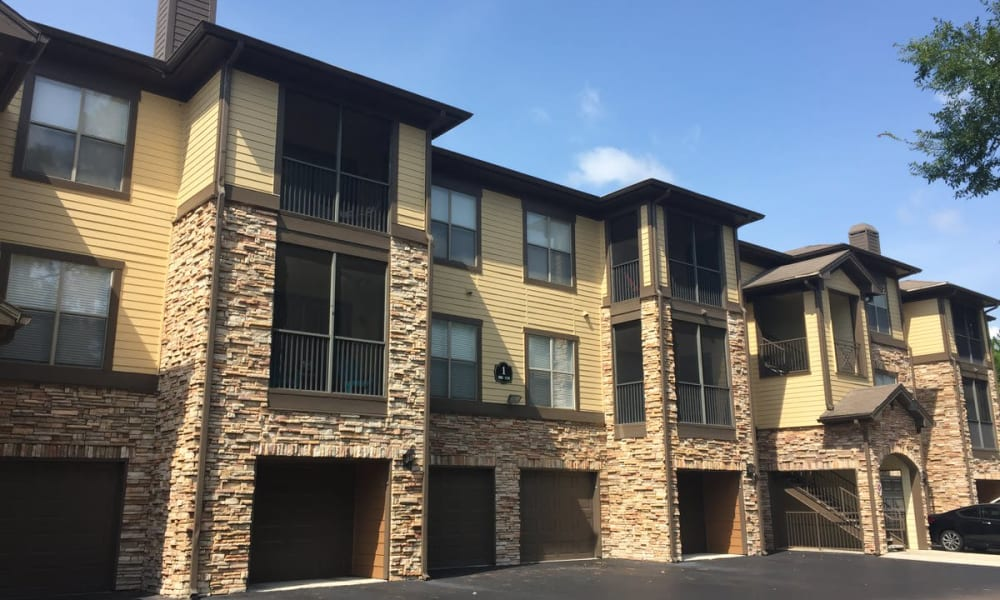 Exterior view of resident buildings with private garages at Wimberly at Deerwood in Jacksonville, Florida