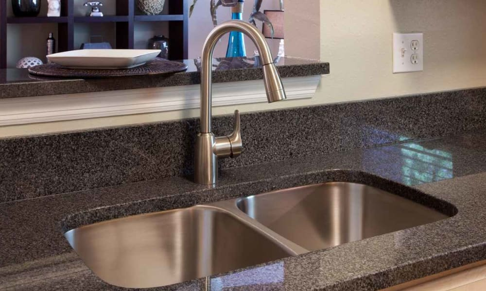 Recessed dual-basin sink in a model home's gourmet kitchen at Wimberly at Deerwood in Jacksonville, Florida