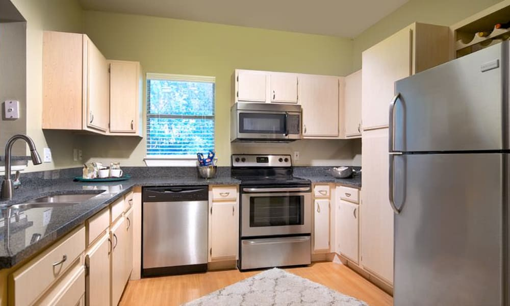 Well-lit gourmet kitchen in a model apartment at Wimberly at Deerwood in Jacksonville, Florida