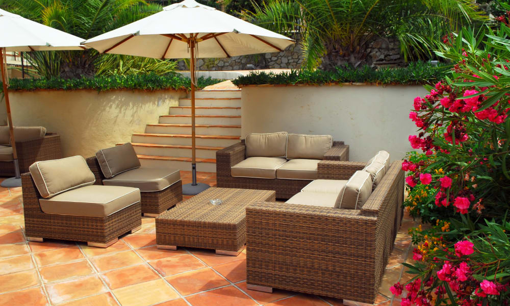 Shaded outdoor lounge area at Olympus Court Apartments in Bakersfield, California