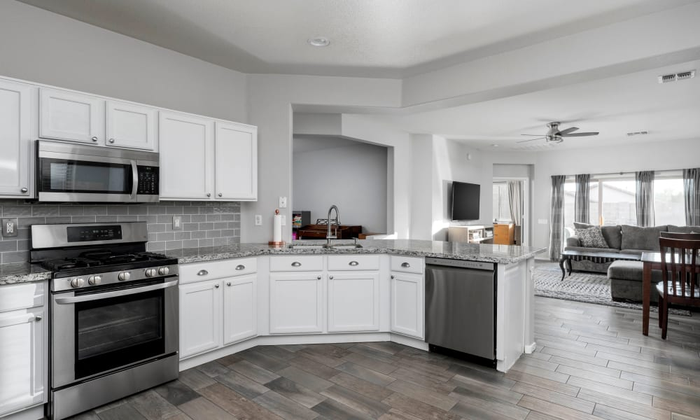 Modern gourmet kitchen in a model apartment at Olympus Court Apartments in Bakersfield, California