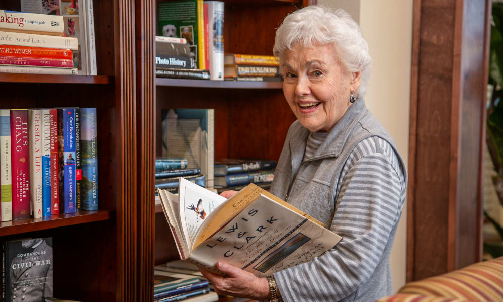 Resident of Kennedy Meadows Gracious Retirement Living in North Billerica, Massachusetts in the library