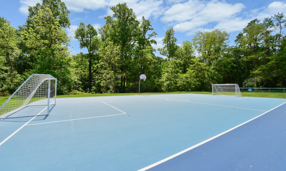 Basketball court with soccer nets at Marchwood Apartment Homes