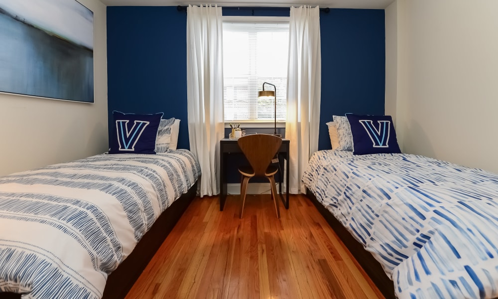 Cozy bedroom with two twin beds at The Villas at Bryn Mawr Apartment Homes