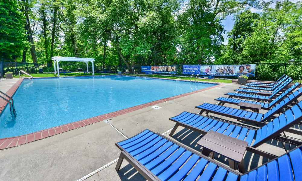 Relax by the pool at The Villas at Bryn Mawr Apartment Homes