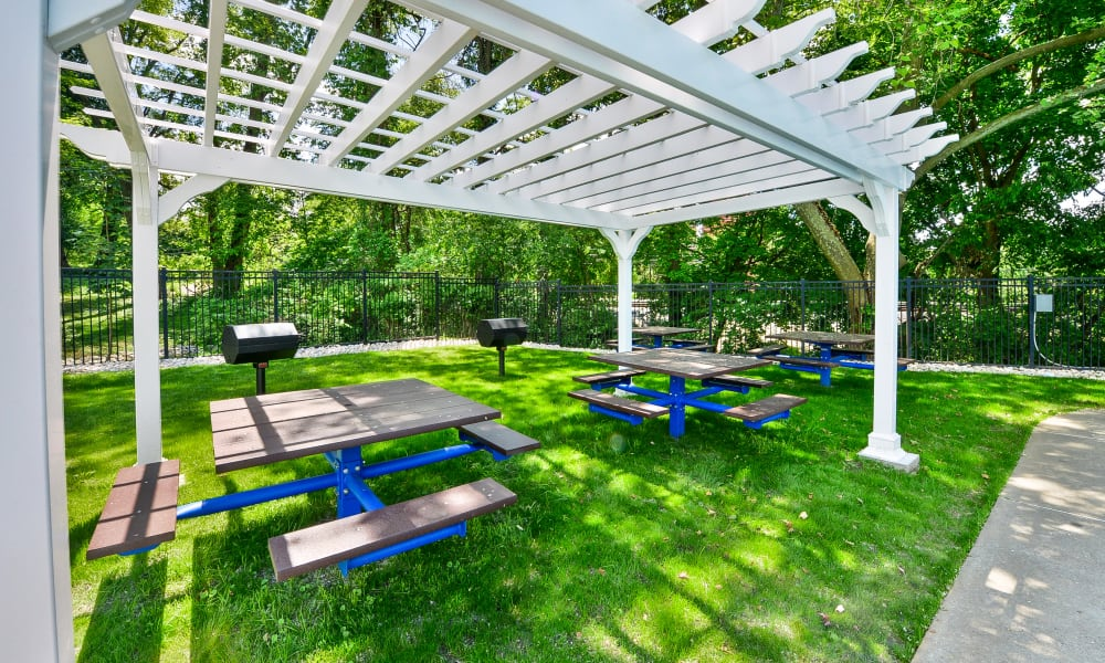 Covered seating with BBQ at The Villas at Bryn Mawr Apartment Homes