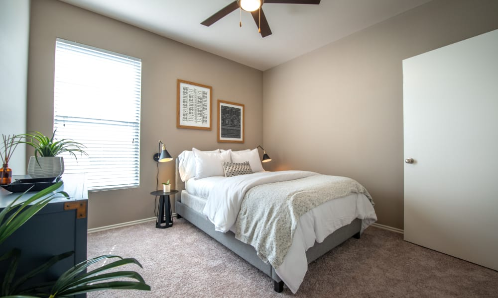 Comfortable and naturally light bedroom at Olympus Team Ranch in Benbrook, Texas