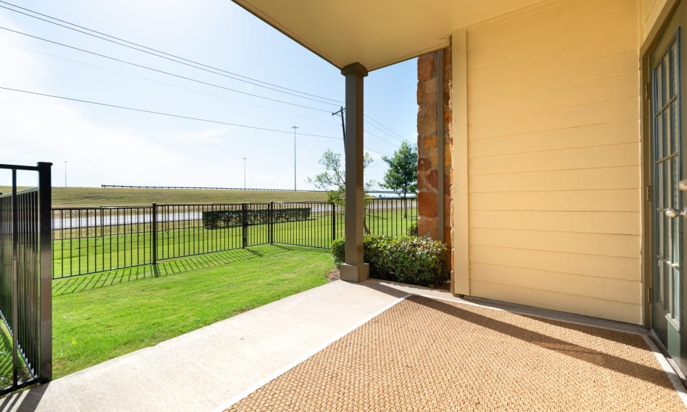Patio and community green space at Olympus Team Ranch in Benbrook, Texas