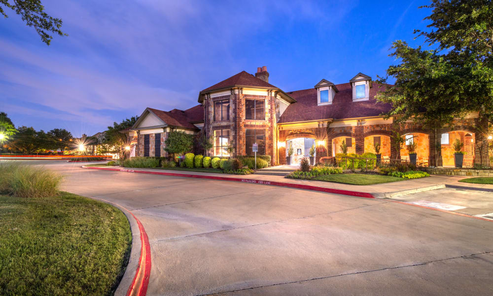 Exterior of Clubhouse at night at Olympus Team Ranch in Benbrook, Texas
