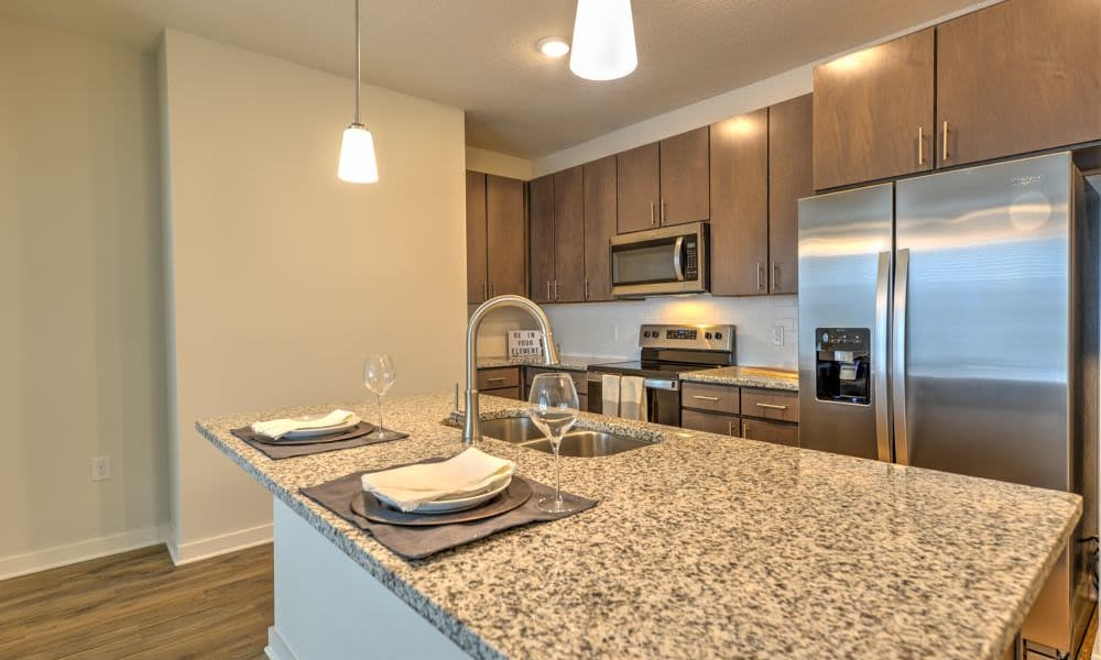 Kitchen with granite counter tops and stainless appliances at Fusion