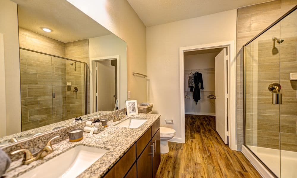 Spacious master bath with walk in closet at Fusion