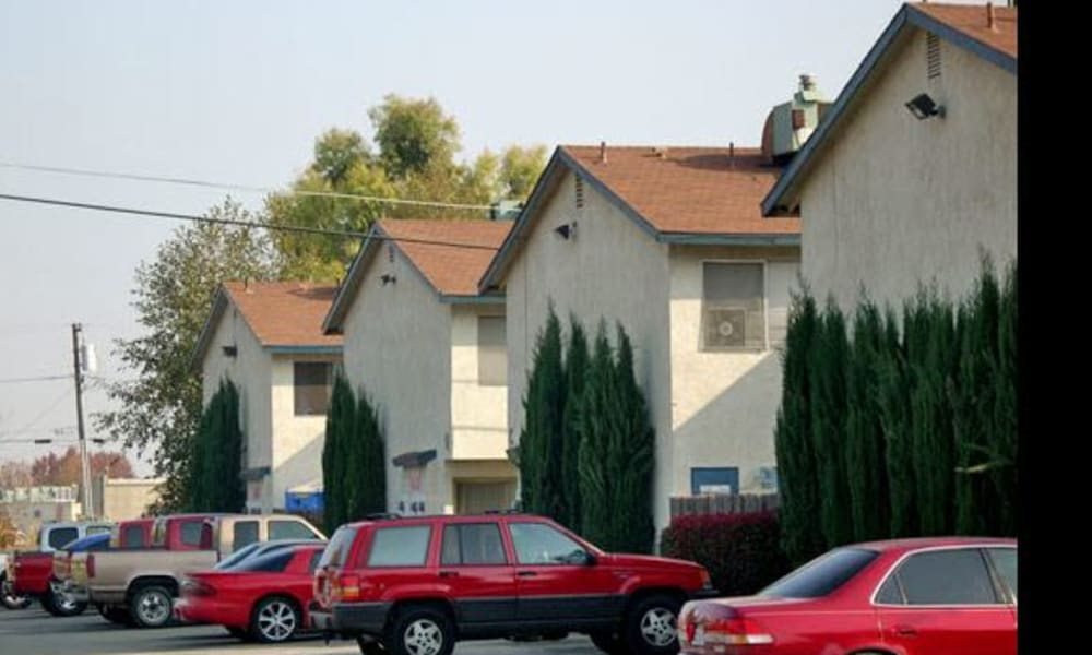 Parking and housing at El Potrero Apartments in Bakersfield, California