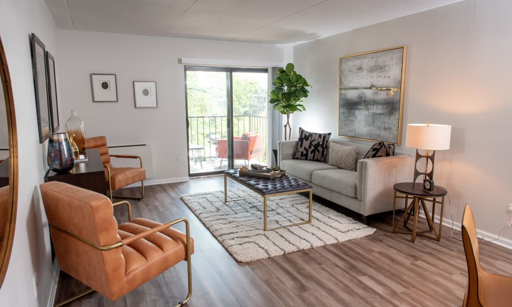 Living room with patio access at Mandalane Apartments in Wheeling, Illinois