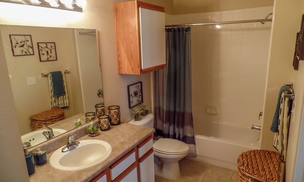 An apartment bathroom at Winchester Apartments in Amarillo, TX
