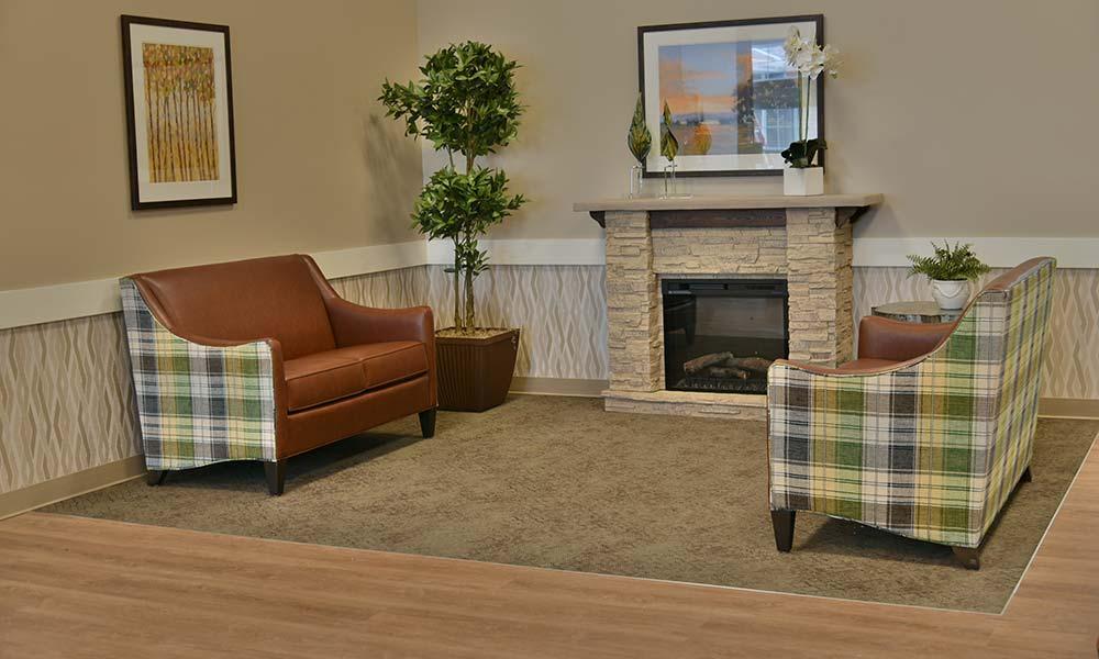 Cozy fireplace seating at Grand Plains in Pratt, Kansas