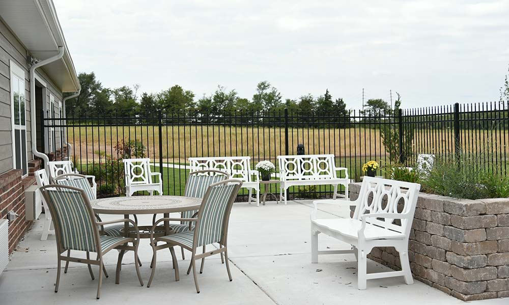 Secure outdoor living spaces at One of two living rooms at Grand Plains in Pratt, Kansas