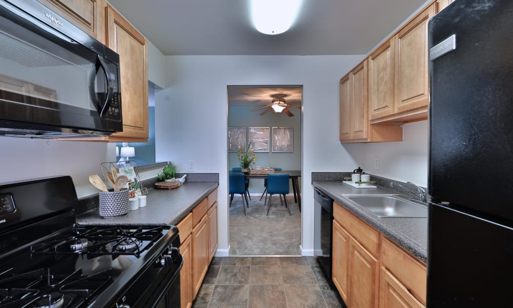 Cedar Gardens and Towers Apartments & Townhomes offers a kitchen in Windsor Mill, MD