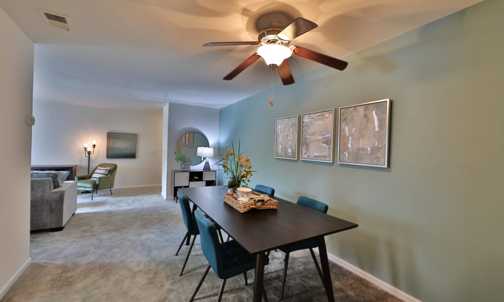 Living dining room combo at Cedar Gardens and Towers Apartments & Townhomes in Windsor Mill, MD