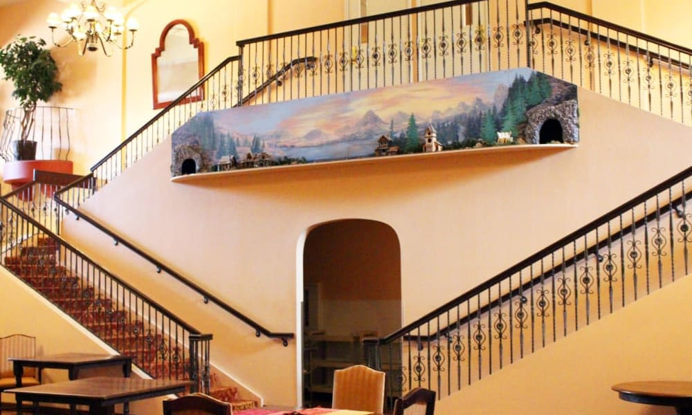 Interior staircase with mural at Pennington Gardens in Chandler, Arizona