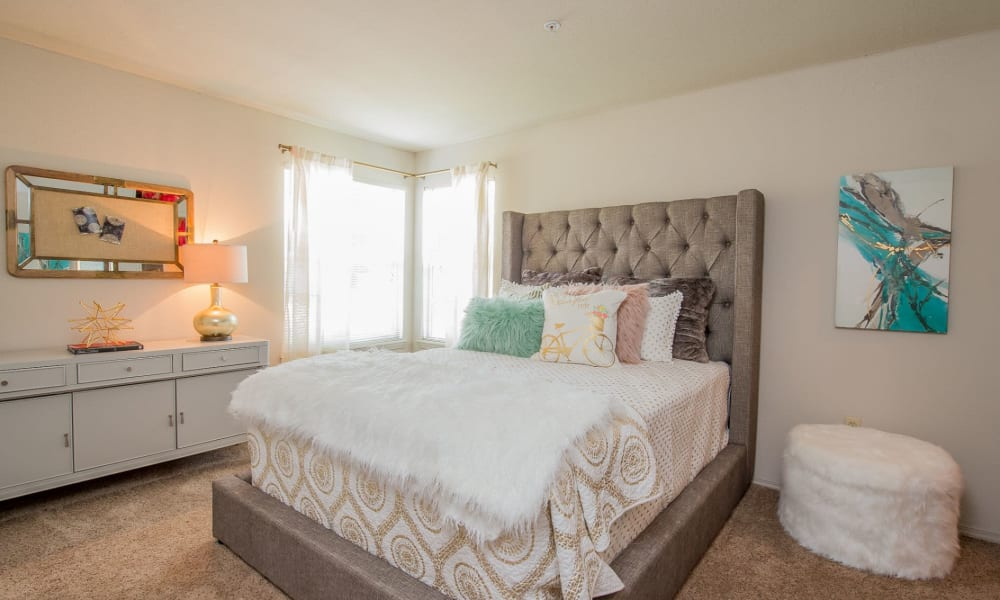 Cozy bedroom at Crown Chase Apartments in Wichita, Kansas