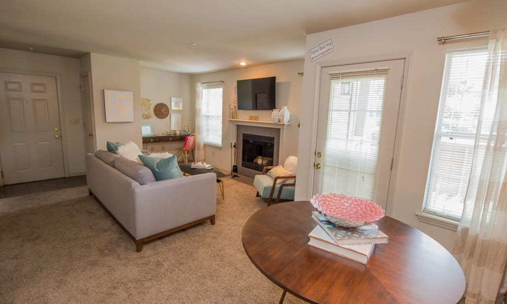 Living room with a fireplace at Crown Chase Apartments in Wichita, Kansas