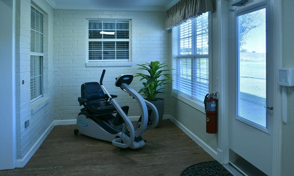 Sunporch with Fitness Equipment at Parkway Cove Memory Care