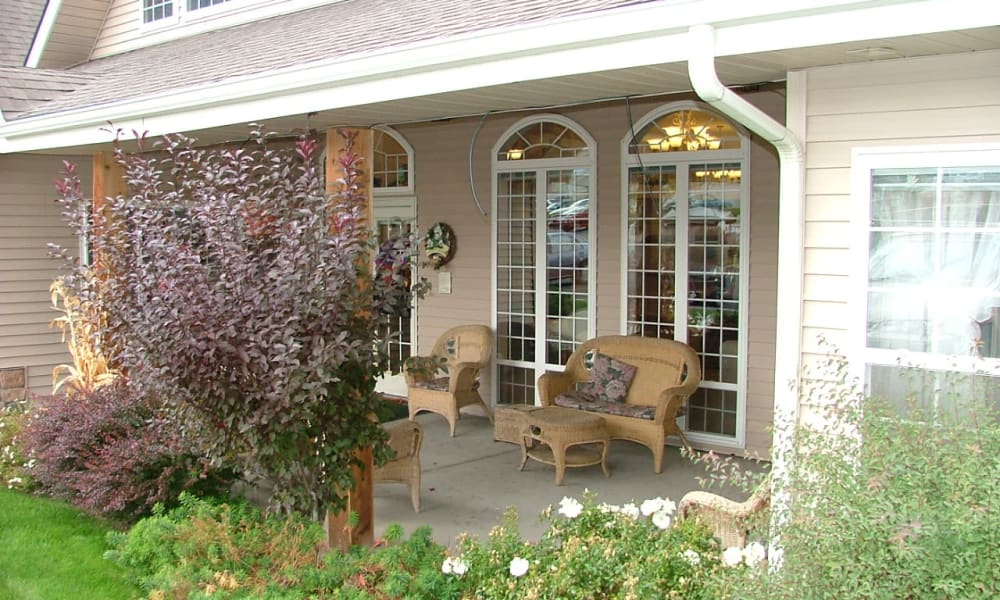 Covered porch with wicker seating at Generations at Lewiston in Lewiston, Idaho