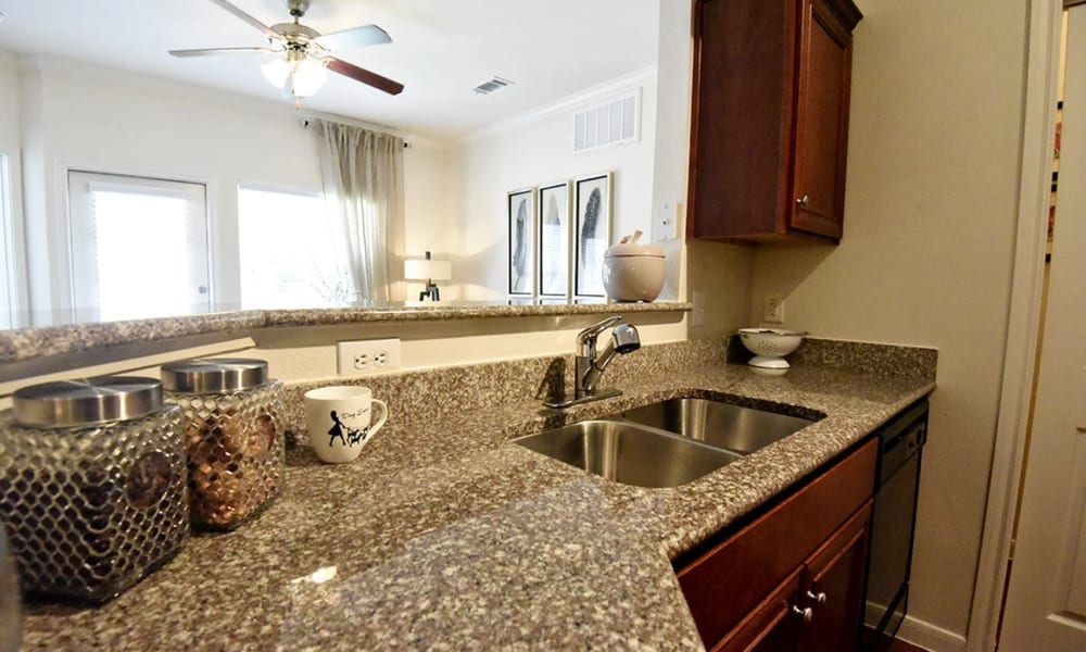 Kitchen with granite countertops at Augusta Meadows in Tomball, Texas