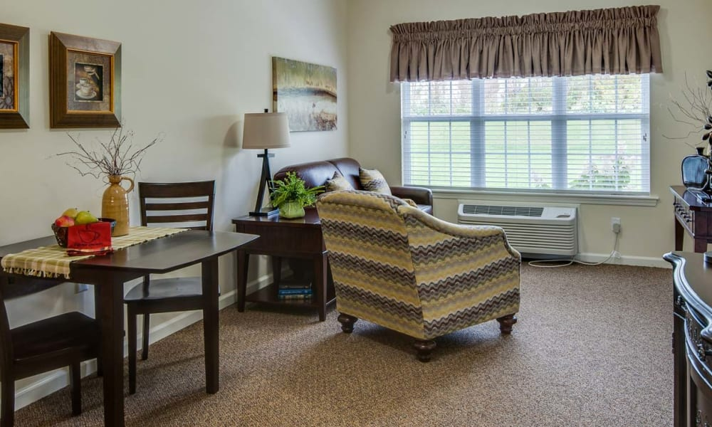 Living area with a window view at Field Pointe Assisted Living in Saint Joseph, Missouri
