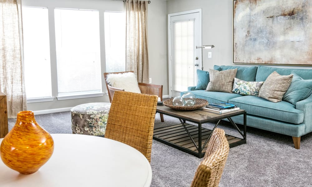 Floor-to-ceiling windows in a model home's living area at Arbor Ridge Apartments in Owings Mills, Maryland