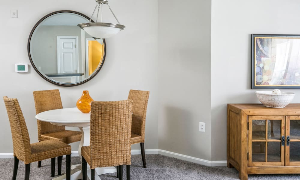 Well-furnished dining nook in a model apartment at Arbor Ridge Apartments in Owings Mills, Maryland