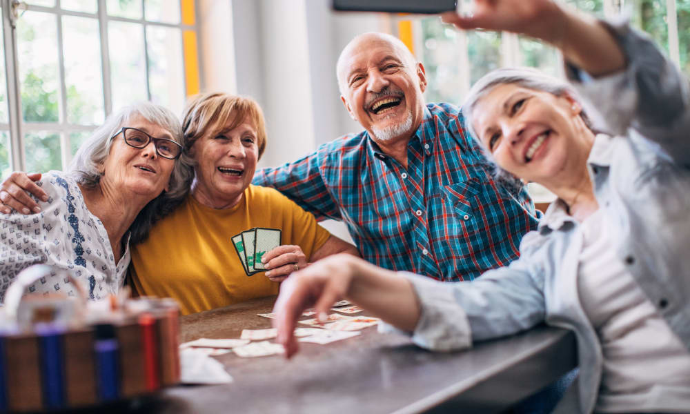 Residents playing cards and taking a selfie at Randall Residence of McHenry in McHenry, Illinois