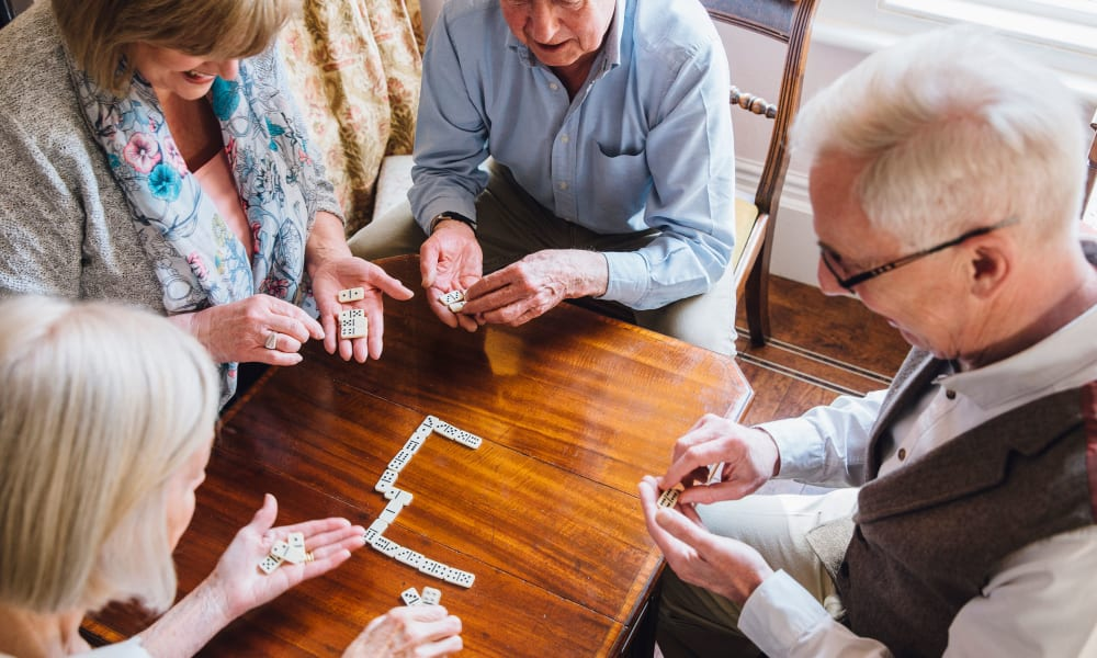 Residents playing board game at Randall Residence of Fremont in Fremont, Ohio