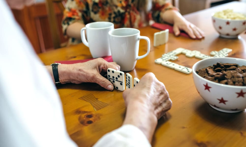Residents play dominoes at Randall Residence of Tiffin in Tiffin, Ohio