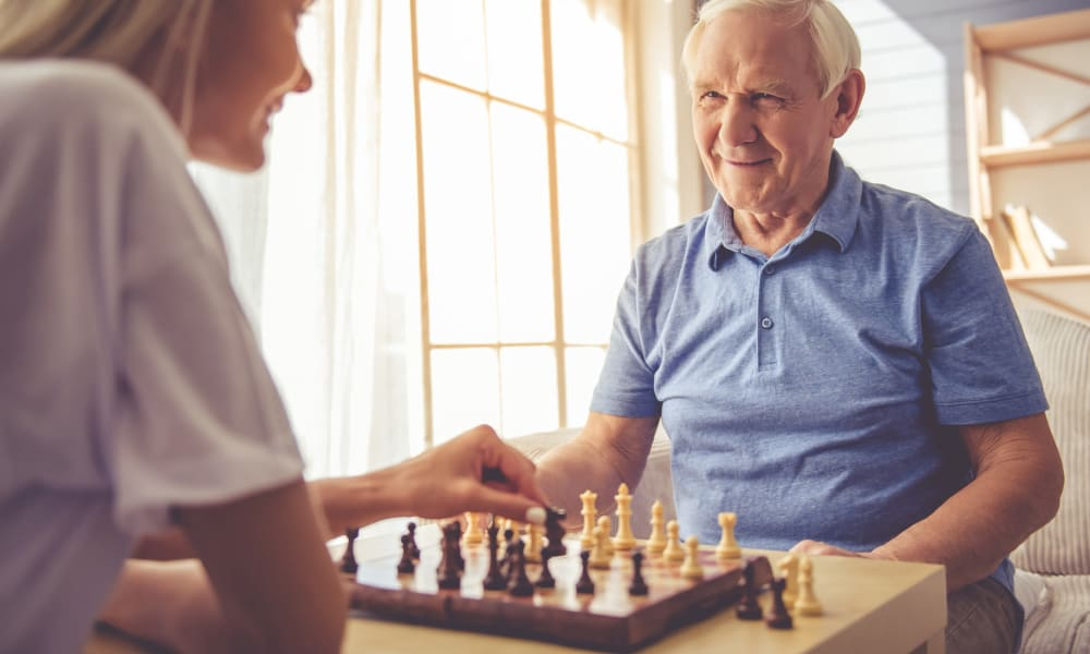 Resident playing chess at Randall Residence of Newark in Newark, Ohio